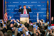 The republican Presidential candidate Donald Trump talks to his supporters in an overcrowd room at a campaign stop in Milford, NH.