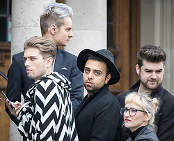 © Licensed to London News Pictures . 30/06/2017 . Stockport , UK . Mourners outside the servie . The funeral of Martyn Hett at Stockport Town Hall . Martyn Hett was 29 years old when he was one of 22 people killed on 22 May 2017 in a murderous terrorist bombing committed by Salman Abedi, after an Ariana Grande concert at the Manchester Arena . Photo credit : Joel Goodman/LNP