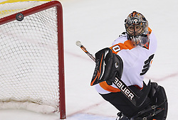 May 6, 2012; Newark, NJ, USA; Philadelphia Flyers goalie Ilya Bryzgalov (30) makes a save during the third period in game four of the 2012 Eastern Conference semifinals at the Prudential Center.  The Devils defeated the Flyers 4-2.