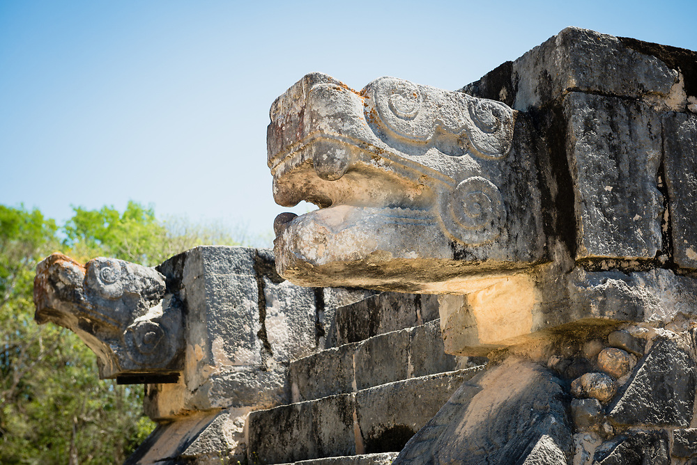 Detail fo jaguar head sculpture at Chichen Itza archeological site, Mexcio
