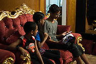 Ahmed Mohamed sets up his virtual reality video game with his cousins in Irving, Texas on July 12, 2016. (Cooper Neill for The Washington Post)