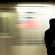 A woman waits for the train to stop at the Port Authority subway station in New York, February 19, 2010.
