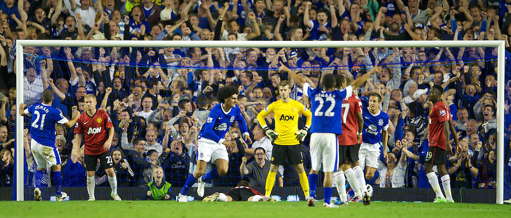 LIVERPOOL, ENGLAND - Monday, August 20, 2012: Everton's Marouane Fellaini celebrates scoring the only goal of the game to seal a 1-0 victory against Manchester United during the Premiership match at Goodison Park. (Pic by David Rawcliffe/Propaganda)
