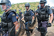 Demonstration of logistics, tactics, and capabilities of each units from PNTL, ( Timorese National Police)  UIR (Rapid Intervention Unit) , Malaysian FPU ( Formed Police Unit), Portuguese FPU and ISF ( International Stabilization Forces) at Tacitolu shooting range. @ UNMIT/Martine Perret. 16 March 2009