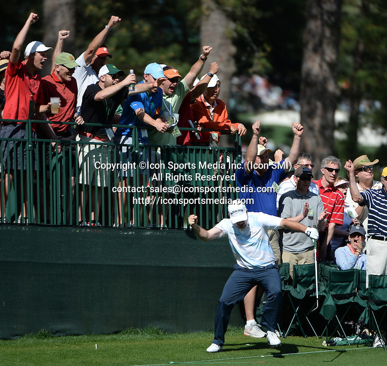 April 12, 2013 - Augusta, Georgia, U.S. - Robert Garrigus celebrates after a chip-in eagle on No. 15 green during the second round of the 2013 Masters Tournament at Augusta National Golf Club on Friday, April 12, 2013, in Augusta, Ga.