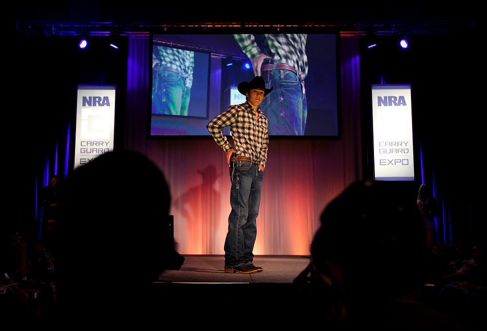 Clay West displays a concealed leather hip holster during the National Rifle Association (NRA) Carry Guard Expo Fashion Show in Milwaukee, Wisconsin, U.S., August 25, 2017.   REUTERS/Ben Brewer