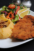 Chicken escalope with mashed potatoes and salad