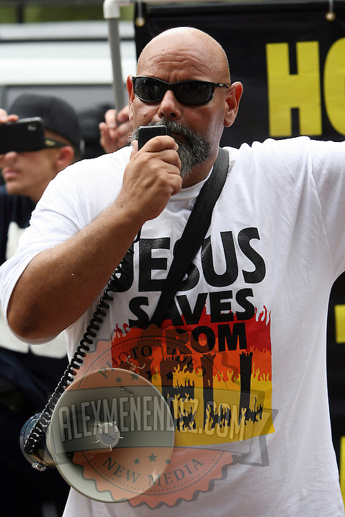 Ruben Israel of the Bible Believers preaches during the Republican National Convention in Tampa, Fla. on Wednesday, August 29, 2012. (AP Photo/Alex Menendez)