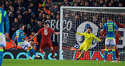 LIVERPOOL, ENGLAND - Tuesday, December 11, 2018: Liverpool's goalkeeper Alisson Becker makes an injury time save from Napoli's Arkadiusz Milik during the UEFA Champions League Group C match between Liverpool FC and SSC Napoli at Anfield. (Pic by David Rawcliffe/Propaganda)