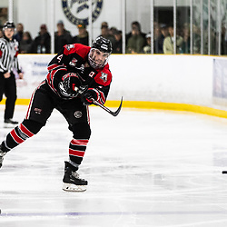 TORONTO, ON - APR 10, 2018: Ontario Junior Hockey League, South West Conference Championship Series. Game seven of the best of seven series between the Georgetown Raiders and the Toronto Patriots, Zac Elson #4 of the Georgetown Raiders shoots the puck down the ice during the third period.<br /> (Photo by Kevin Raposo / OJHL Images)