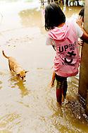 Young girl at Mandalay flooded street