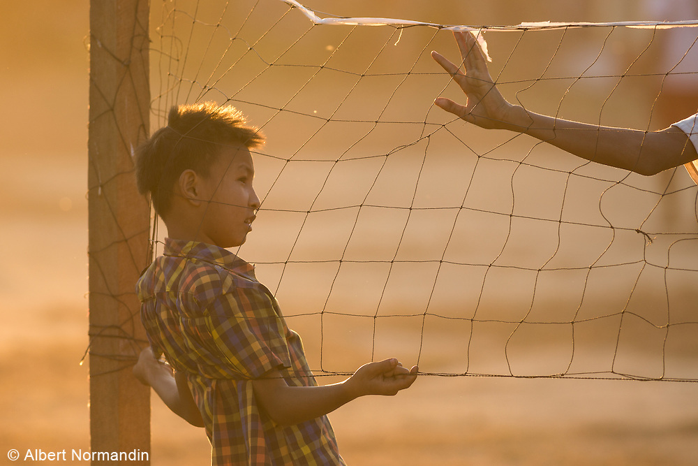 Boys hanging around at sports net, Myitkyina