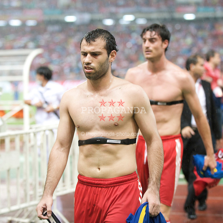 BANGKOK, THAILAND - Wednesday, July 22, 2009: Liverpool's Javier Mascherano and Albert Riera after the Reds' 1-1 draw with Thailand during a preseason friendly match at the Rajamangala Stadium. (Pic by David Rawcliffe/Propaganda)