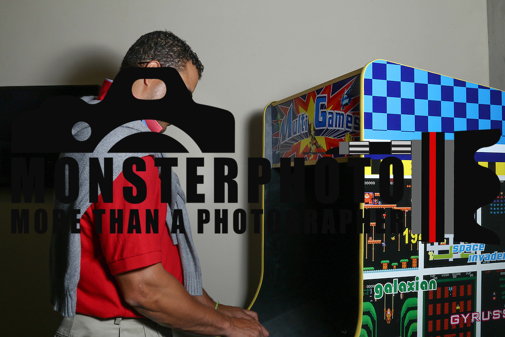 David Woods plays a vintage arcade game during the Autism Delaware Back to the '80s gala Saturday, Nov. 21, 2015 at World Cafe Live at the Queen in Wilmington.