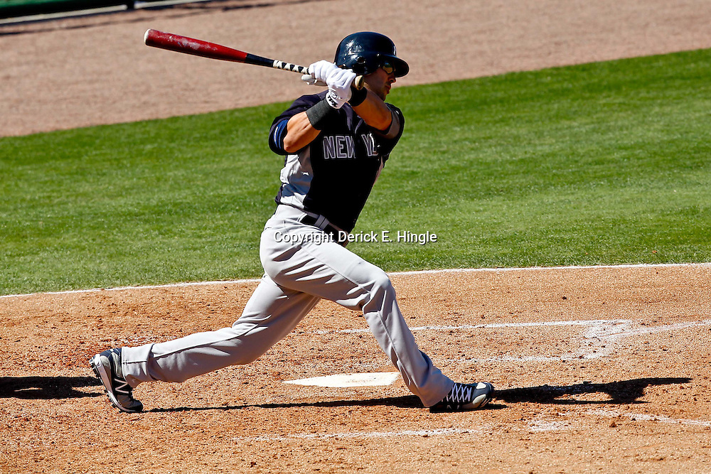 March 05, 2011; Clearwater, FL, USA; New York Yankees right fielder Nick Swisher (33) at ball during a spring training game against the Philadelphia Phillies  at Bright House Networks Field. Mandatory Credit: Derick E. Hingle-US PRESSWIRE