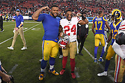 Dec 30, 2018; Los Angeles, CA, USA; Los Angeles Rams defensive end Aaron Donald (99) and San Francisco 49ers defensive back K'Waun Williams (24) pose for a picture at Los Angeles Memorial Coliseum. The Rams defeated the 49ers 48-31.  (Robin Alam/Image of Sport)