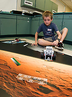 "Luke programs his Lego robotic droid for a mission on Mars during ""Let Go Your Mind"" summer camp through Gilford Parks and Recreation held at the Gilford Middle School on Wednesday.  (Karen Bobotas/for the Laconia Daily Sun)"