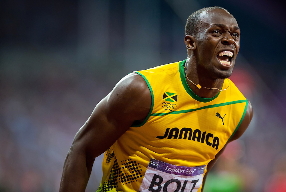 Usain Bolt of Jamaica, left, celebrated after winning the gold medal in the men's 200m final in a time of 19.32 at Olympic Stadium during the 2012 Summer Olympic Games in London, England, Thursday, August 9, 2012. (David Eulitt/Kansas City Star/MCT)