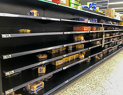 © Licensed to London News Pictures. 03/03/2020. London, UK. Empty shelves on the bread aisle. Panic-buying starts to show in this ASDA store in Wandsworth as shelves empty out of goods. Earlier, Boris Johnson announced his battle plan in Downing Street for combating the coronavirus crisis. Photo credit: Alex Lentati/LNP