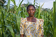 Mrs Beatrice Sebyala stands within her crop of maize at her farm. She is the chairperson and a group leader for the Basokakwayula group, one of the groups trained by Kulika. Beatrice now uses her farm as a demo and example for other farmers.