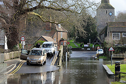 © Licensed to London News Pictures. 28/01/2014<br /> Wet and cold weather conditions continue across the UK.<br /> Drivers stop on the Bridge to check water before driving through. <br /> The river Darent water level in Eynsford,Kent remains high flooding parts of the Riverside at the Ford. <br /> Photo credit :Grant Falvey/LNP