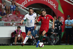 September 10, 2018 - Lisbon, Portugal - Portugal's forward Bernardo Silva (R ) vies with Italy's midfielder Giacomo Bonaventura during the UEFA Nations League A group 3 football match Portugal vs Italy at the Luz stadium in Lisbon, Portugal on September 10, 2018. (Credit Image: © Pedro Fiuza/ZUMA Wire)