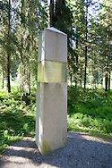 The execution site, Falstad Forest, lies one kilometre south of the Falstad Building. Approximately 220 prisoners were executed here in the period 1942-43. Before liberation on the 8th of May 1945, an unknown number of remains of the executed were sunk in the Trondheim Fjord. Presumably Falstad Forest still conceals unknown graves. During the summer of 1945 known graves were opened and the remains identified. In the years 1945-52, a total number of 49 graves were found in Falstad Forest. The burial places are today marked with stone pyramids. Names of the executed are carved on a cenotaph in the forest. For prisoners of Yugoslav or Soviet Russian origin, Falstad served as a death camp...A monument in Falstad Forest was unveiled by HRH Crown Prince Olav in 1947. Falstad Forest is today a national cultural monument and a war grave site...Falstadskogen ligger en kilometer sør for Falstadbygningen. Vel 220 fanger ble henrettet her i årene 1942-44. Av dem var 43 nordmenn, om lag 74 jugoslaver og over 100 sovjetere. Falstad var en dødsleir for jugoslaviske og sovjetiske krigsfanger...I juni 1945 ble de første påviste gravstedene åpnet og døde iden-tifisert. I årene 1945-52 ble totalt 49 graver funnet i Falstad-skogen, flere av dem massegraver. Gravstedene er i dag markert med steinpyramider. I skogen ligger en minneplate med navn på henrettede. Trolig finnes fortsatt ukjente graver i Falstadskogen...Daværende Kronprins Olav avduket i 1947 et minnemonument i Falstadskogen. Falstadskogen er i dag et nasjonalt kulturminne og en offentlig krigsgravplass.