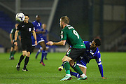 The referee watches on whilst Jamie Reckord of Oldham Athletic and Scunthorpe United striker Paddy Madden (9) battle for the ball during the EFL Sky Bet League 1 match between Oldham Athletic and Scunthorpe United at Boundary Park, Oldham, England on 18 October 2016. Photo by Simon Brady.