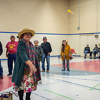 """Cici Varanauskas, dressed as """"Princesses Diana"""", throws a dart at the balloons tacked to a board, at the Senior Center Halloween costume contest on Wednesday in Gallup."""