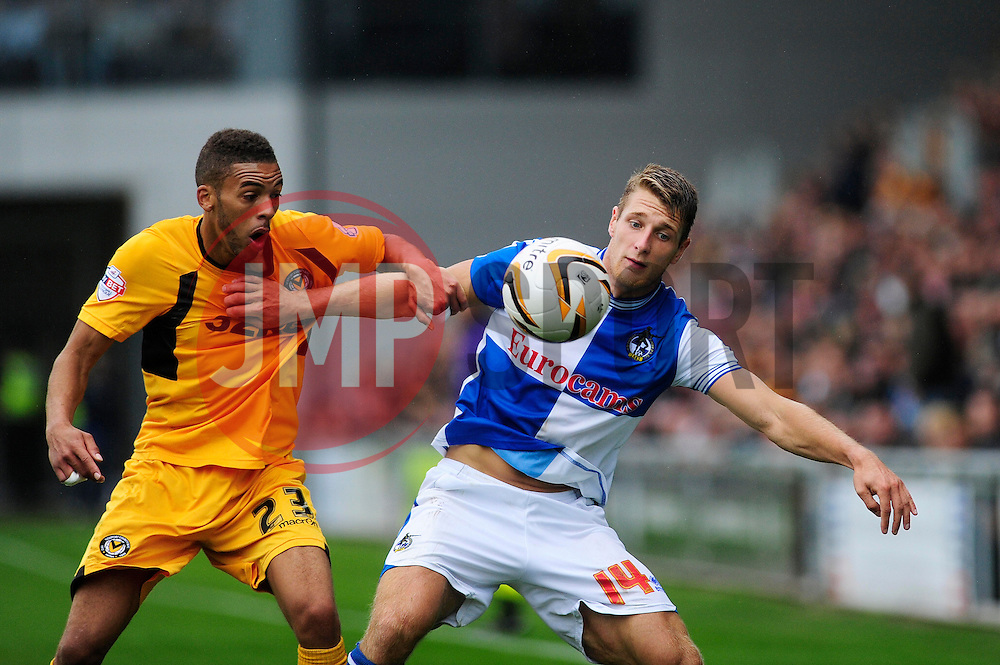 Bristol Rovers' Lee Brown holds off Bristol Rovers' Lee Brown  - Photo mandatory by-line: Dougie Allward/JMP - Tel: Mobile: 07966 386802 17/08/2013 - SPORT - FOOTBALL - Rodney Parade - London - Newport County V Bristol Rovers - Sky Bet league two