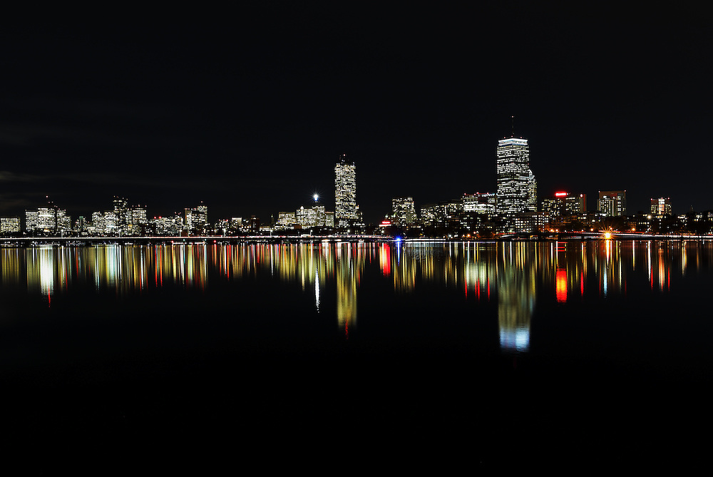 Boston skyline night photography featuring classic landmarks along the Charles River like the famous Prudential Center and 200 Clarendon better known as the John Hancock Tower. This Boston skyline photography image at night reflected in the quiet Charles River is available as museum quality photography prints, canvas prints, acrylic prints, wood prints or metal prints. Fine art prints may be framed and matted to the individual liking and decorating needs:<br />  <br /> http://juergen-roth.pixels.com/featured/dark-as-night-juergen-roth.html<br /> <br /> All Boston skyline night photography photos are available for digital and print photography image licensing at www.RothGalleries.com. Please contact me direct with any questions or request.<br /> <br /> Good light and happy photo making!<br /> <br /> My best,<br /> <br /> Juergen<br /> Prints: http://www.rothgalleries.com<br /> Photo Blog: http://whereintheworldisjuergen.blogspot.com<br /> Instagram: https://www.instagram.com/rothgalleries<br /> Twitter: https://twitter.com/naturefineart<br /> Facebook: https://www.facebook.com/naturefineart