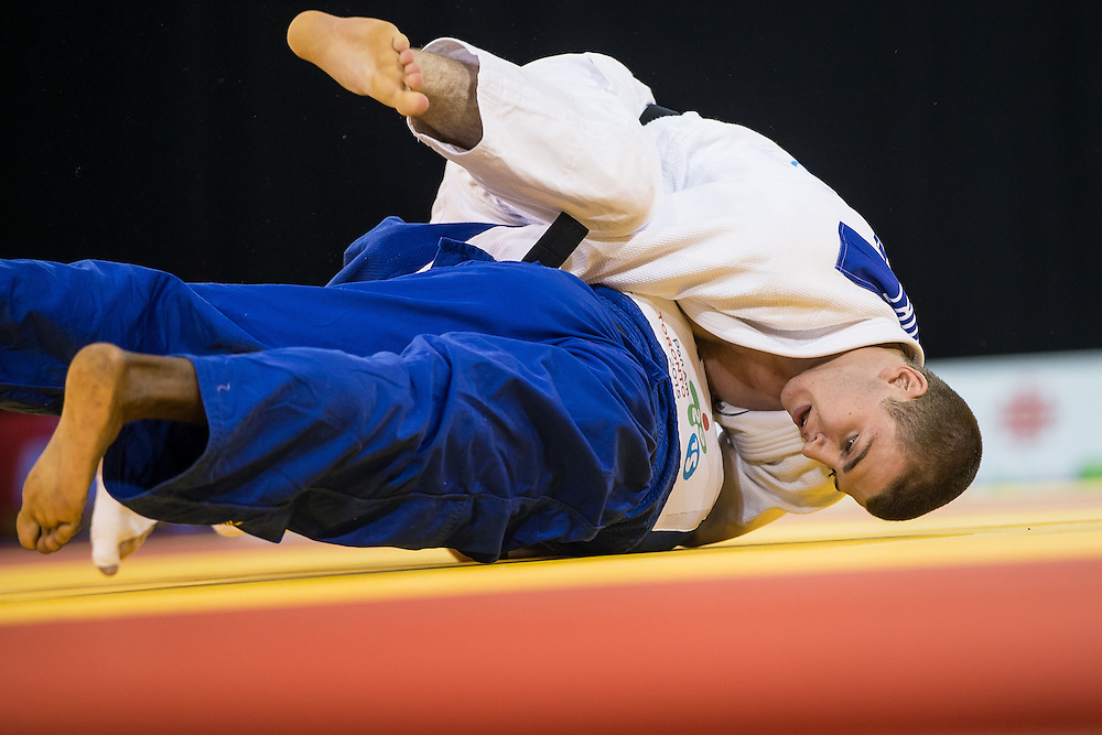 Zachary Burt (Top) of Canada and Pedro Castro of Colombia struggle for position during their bronze medal contest in the men's judo -81kg class at the 2015 Pan American Games in Toronto, Canada, July 13,  2015. AFP PHOTO/GEOFF ROBINS