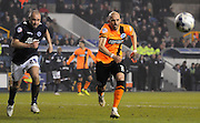 Bruno Saltor and Gary Taylor-Fletcher chase down the loose ball during the Sky Bet Championship match between Millwall and Brighton and Hove Albion at The Den, London, England on 17 March 2015. Photo by Michael Hulf.