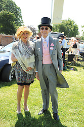 Rolling Stone CHARLIE WATTS and his wife SHIRLEY at the third day of the Royal Ascot 2010 (Ladies Day) Racing Festival at Ascot Racecourse, Bershire on 17th June 2010.