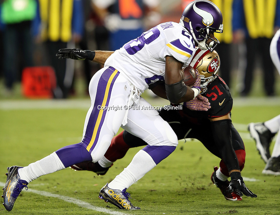 Minnesota Vikings running back Adrian Peterson (28) gets hit in the backfield by San Francisco 49ers inside linebacker Michael Wilhoite (57) as he runs the ball in the first quarter during the 2015 NFL week 1 regular season football game against the San Francisco 49ers on Monday, Sept. 14, 2015 in Santa Clara, Calif. The 49ers won the game 20-3. (©Paul Anthony Spinelli)