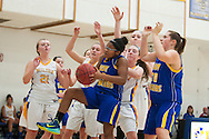 Lamoille's Emily Peck (10) grabs the rebound during the girls basketball game between Lamoille and Milton at Milton High School on Friday night December 18, 2015 in Milton, (BRIAN JENKINS/for the FREE PRESS)