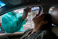A 'PCR screening test' is done in the car, outside a medical lab in Boulogne Billancourt, near Paris, France, on May 2, 2020 on 47th day of lock down to prevent the spread of the epidemic COVID-19. Photo by Ammar Abd Rabbo/ABACAPRESS.COM