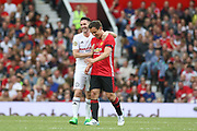 Michael Carrick All-Stars Robbie Keane shares a joke after Manchester United 08 XI Gary Neville miss during the Michael Carrick Testimonial Match between Manchester United 2008 XI and Michael Carrick All-Star XI at Old Trafford, Manchester, England on 4 June 2017. Photo by Phil Duncan.