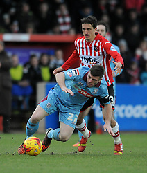 Exeter City's Craig Woodman is challenged by Tranmere Rovers's Steven Jennings - Photo mandatory by-line: Dougie Allward/JMP - Mobile: 07966 386802 - 31/01/2015 - SPORT - Football - Exeter - St James Park - Exeter City v Tranmere Rovers - Sky Bet League Two