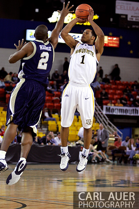 25 November 2005: Marquette Golden Eagle Dominic James (1), a freshman guard, attempts a three point shot over ORU's Chris Riouse (2) in the Marquette University 73-70 victory over Oral Roberts University at the Great Alaska Shootout in Anchorage, Alaska