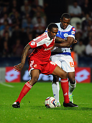 Swindon Town's Nile Ranger and Queen Park Rangers' Nedum Onuoha  - Photo mandatory by-line: Seb Daly/JMP - Tel: Mobile: 07966 386802 27/08/2013 - SPORT - FOOTBALL - Loftus Road - London - Queens Park Rangers V Swindon Town -  Capital One Cup - Round 2