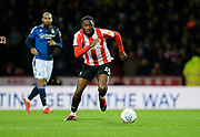 Brentford player Josh Dasilva moves the ball forward in the second half during the EFL Sky Bet Championship match between Brentford and Nottingham Forest at Griffin Park, London, England on 28 January 2020.