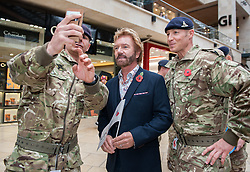 © Licensed to London News Pictures. 29/10/2015. Bristol, UK. Bristol Poppy Day. NOEL EDMONDS joins members of the Royal Artillery to raise the profile of the Royal British Legion's Poppy Appeal campaign in Bristol at Cabot Circus shopping centre, in the two week countdown to Remembrance Day. Photo credit : Simon Chapman/LNP