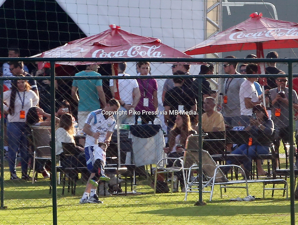Fifa Soccer World Cup - Brazil 2014 - <br /> ARGENTINA, family day party at the training camp in Cidade do Galo -  Belo Horizonte - Brazil (BRA) - 22 Jun 2014 <br /> Argentine players, enjoy a family day after win yesterday match Vs. Iran 1-0<br /> Here Argentine International player Lionel Messi enjoy playing football with his little son THIAGO and with his wife ANTONELLA ROCCUZZO and others parents<br /> &copy; PikoPress