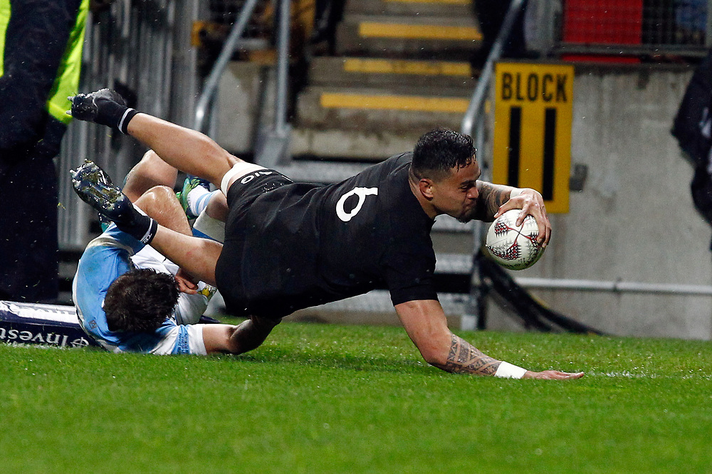 New Zealand's Vaea Fifita, right, dives over Argentina's Santiago Cordero to score in the Investic Rugby Championship Test match at Yarrow Stadium, New Plymouth, New Zealand, Saturday, September 09, 2017. Credit:SNPA / Dean Pemberton  **NO ARCHIVING**
