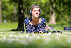 © Licensed to London News Pictures. 14/05/2019. London, UK. A woman enjoys warm sunny weather in London's St James's Park. Temperatures are set to reach 19C in the capital and potentially higher in the some parts of the UK. Photo credit: Dinendra Haria/LNP