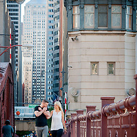 Kirsten and Ben march down LaSalle during their Chicago engagement session - Chicago Wedding Photography