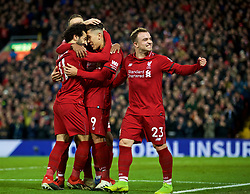 LIVERPOOL, ENGLAND - Saturday, December 29, 2018: Liverpool's Roberto Firmino celebrates scoring the fifth goal with team-mates Mohamed Salah (L) and Sheridan Shaqiri (R) during the FA Premier League match between Liverpool FC and Arsenal FC at Anfield. (Pic by David Rawcliffe/Propaganda)