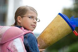 11.09.2010, Graz, AUT, Feature, im Bild ein Schulkind am ersten Schultag mit Schultuete am Weg zur ersten Klasse der Volksschule, EXPA Pictures © 2012, PhotoCredit: EXPA/ Erwin Scheriau