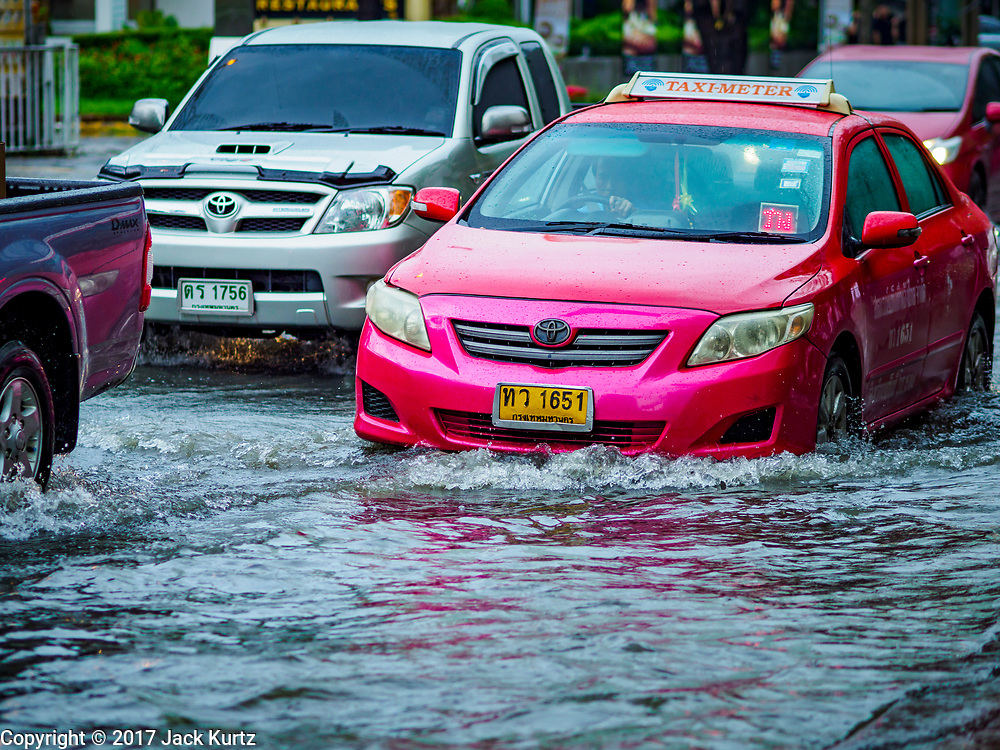 27 MAY 2017 - BANGKOK, THAILAND: Traffic on Ekkamai Road, flooded by monsoonal rains, in suburban Bangkok. The rainy season in Bangkok usually starts in mid-June but started almost a month early this year. There have been daily thunderstorms and localized flooding throughout central Thailand since the middle of May.     PHOTO BY JACK KURTZ